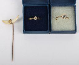 A 9ct diamond and sapphire three stone ring (1.09g)