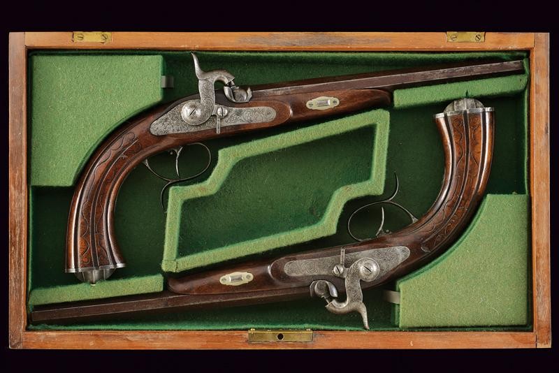 A pair of cased percussion pistols by Kuchenreuter