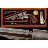 A cased Colt Model 1849 Pocket Revolver