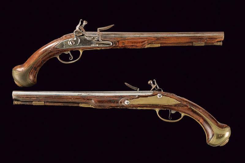 A pair of flintlock holster pistols
