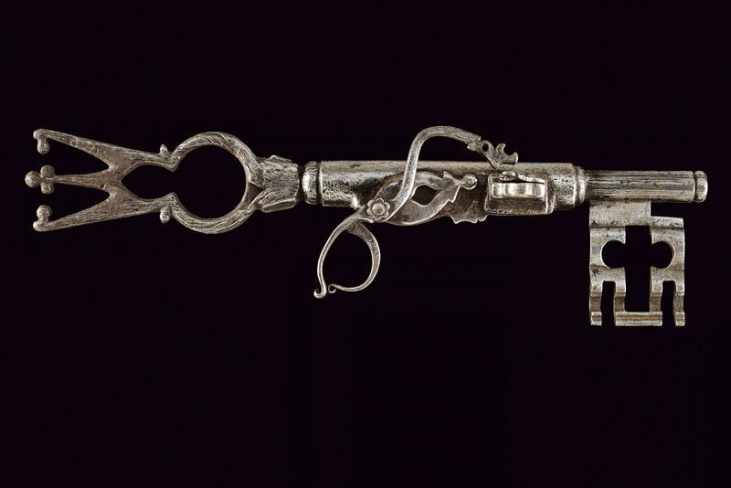 A big key with matchlock pistol