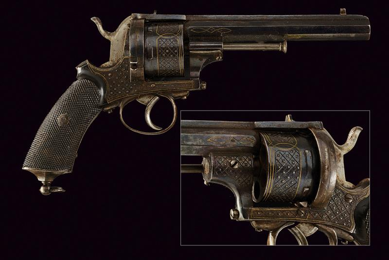 An engraved pinfire revolver