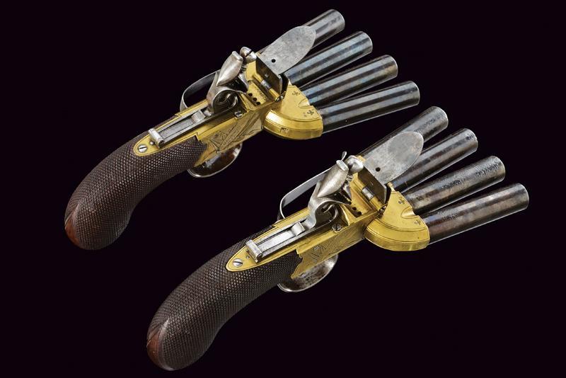 A very scarce pair of duck's foot flintlock pistols by Goodwin & Co.