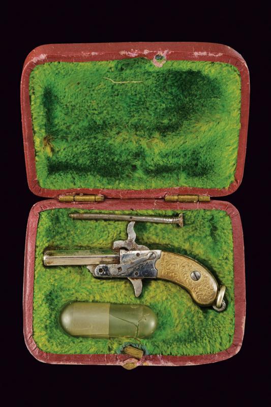 A pin-fire miniature pistol