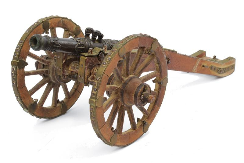 A miniature table cannon with suppor