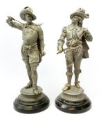 Pair of stripped 19th century spelter figures of cavaliers with brass detailing, each standing with