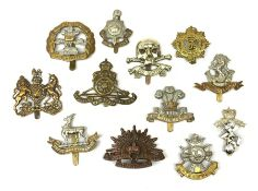 Twelve metal cap badges including South Lancashire Prince of Wales Volunteers, Australian Commonweal