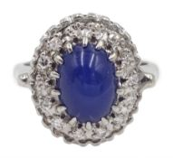White gold star sapphire and diamond cluster ring, stamped 14K