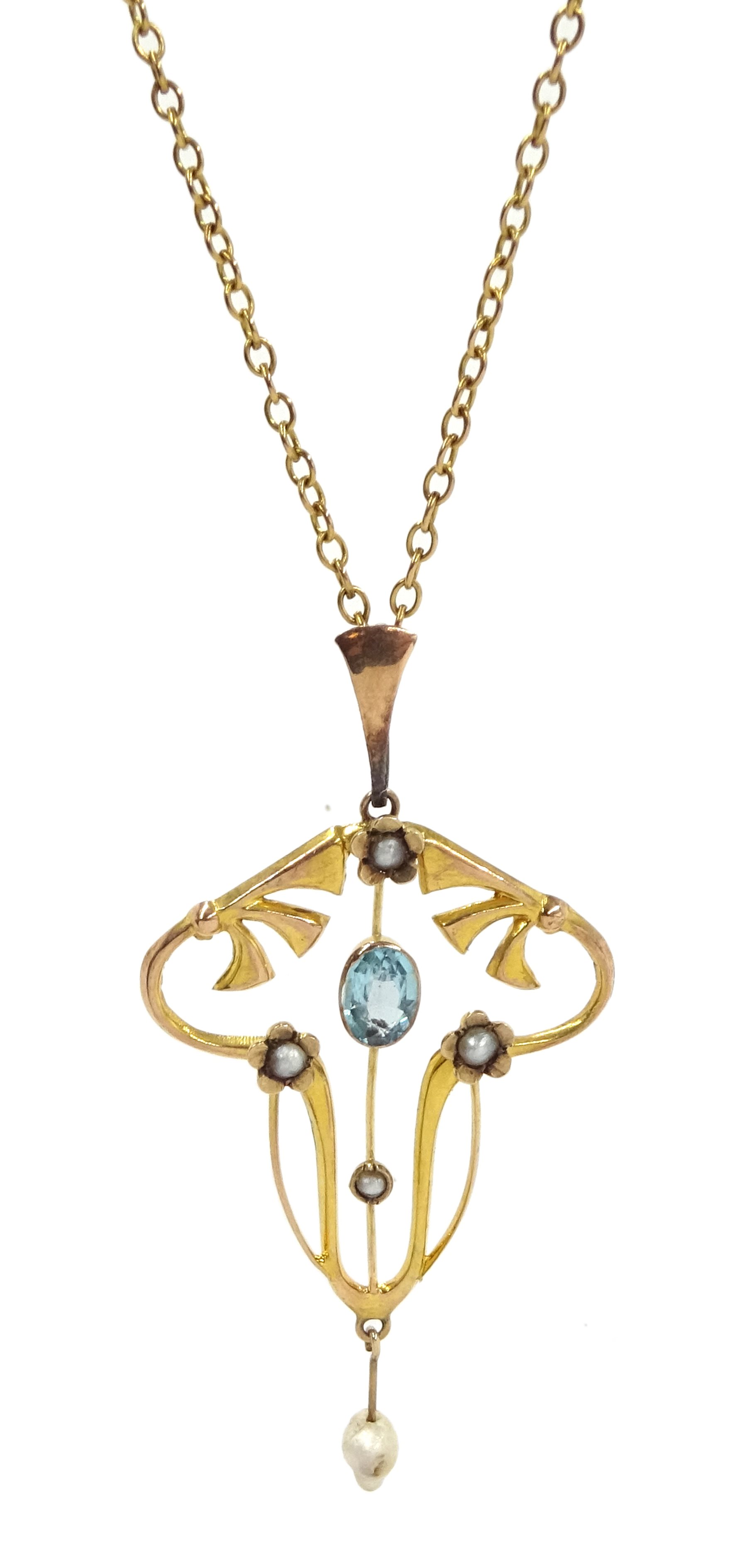 Edwardian 9ct gold blue topaz and seed pearl pendant, on 13ct gold chain necklace with clasp stamped