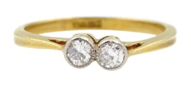 Early 20th century gold two stone milgrain set old cut diamond ring, stamped 18ct