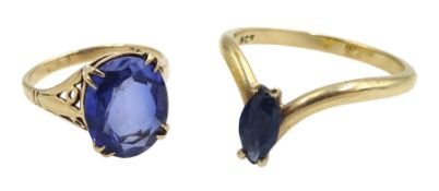Gold marquise shaped sapphire wishbone ring and a gold synthetic oval sapphire ring, both stamped 9