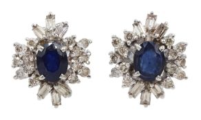 Pair of 18ct white gold oval sapphire, baguette and round brilliant cut diamond stud earrings, stamp