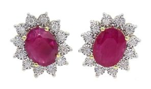 Pair of 9ct gold oval ruby and diamond cluster stud earrings, total ruby weight approx 3.85 carat
