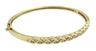 9ct gold diamond hinged bangle, twenty two round brilliant cut diamonds set in a weave design, stamp