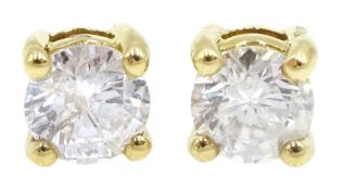 Pair of 18ct gold diamond stud earrings, stamped 750, total diamond weight 0.64 carat
