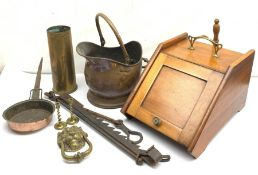 An Edwardian walnut coal scuttle, with shovel, D47cm, together with a copper coal scuttle, a cast br