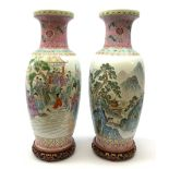 A pair of large Chinese famile rose style vases, one decorated with figural scene, the other with mo