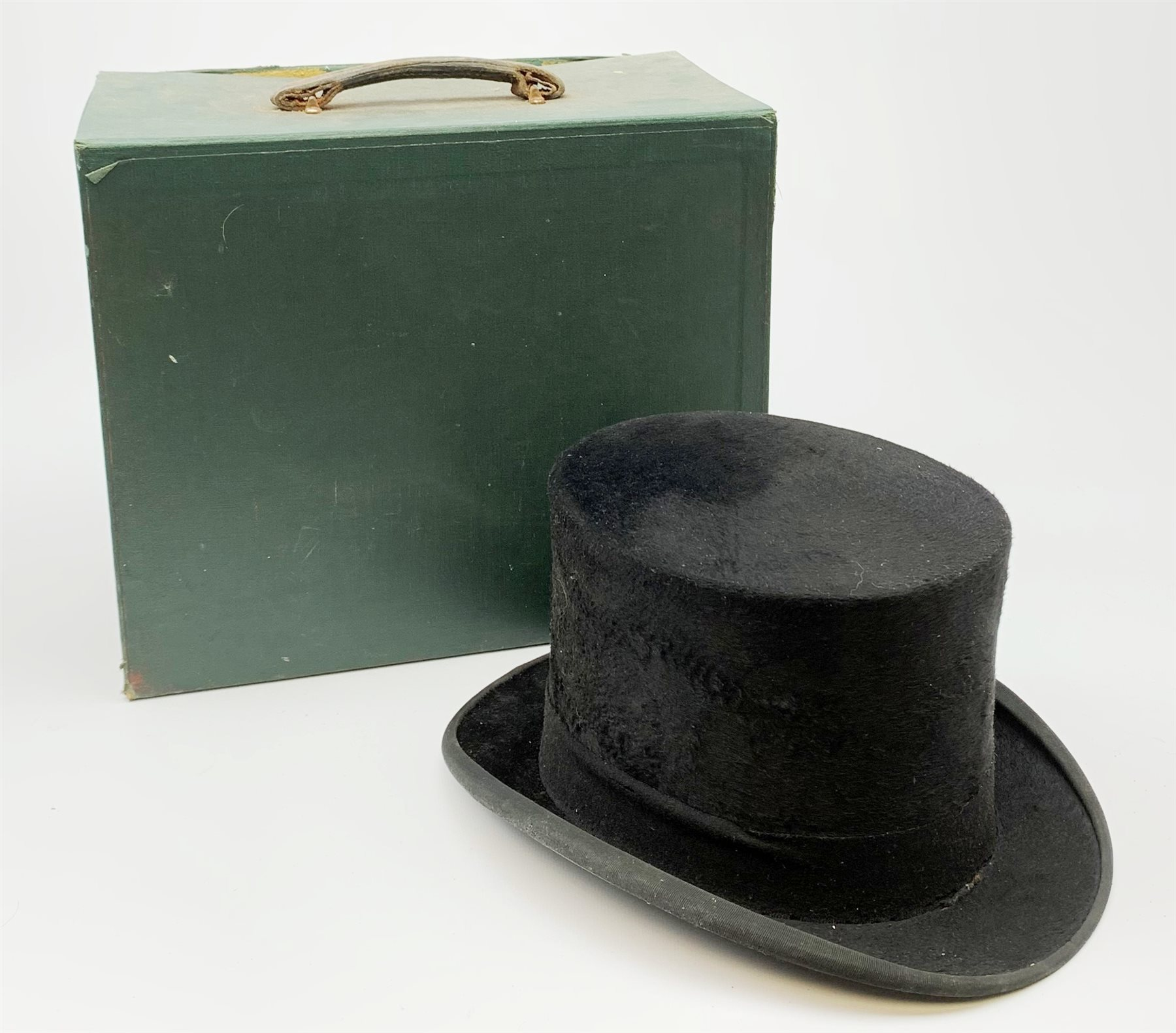 A Vintage black Dunn & Co London top hat, interior circumference measures approximately 58cm, with