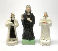 Three 19th century Staffordshire pottery figures, each modelled as John Wesley, largest H20.5cm.