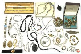 A collection of Vintage and later costume jewellery, to include a ladies Gucci wrist watch, a jet pe