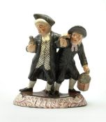 A 19th century Staffordshire figure group, 'Town Crier and Drunk', upon oval scroll detailed base, H