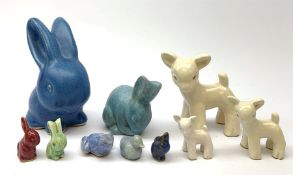 A collection of various Denby models, comprising a blue glazed rabbit, a set of three graduated shee