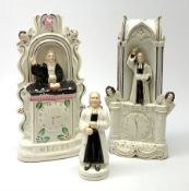 A Staffordshire pulpit group, modelled as John Wesley, H28.5cm, together with another similar Staffo