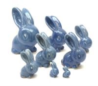 A collection of eight Denby blue glazed models of the Rabbits Marmaduke and Cotton tail, various siz