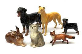 A group of Beswick figures, comprising a Rottweiler, and Rottweiler puppy, Grey Hound marked CH Jovi