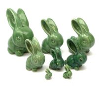 A collection of eight Denby green glazed models of the Rabbits Marmaduke and Cotton tail, various si