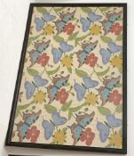 A large framed and glazed crewelwork embroidery, depicting butterflies amidst flowering vines, upon
