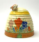 A Clarice Cliff Newport Pottery honey pot, modelled in the form of a beehive and decorated in the Cr