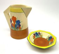 A Clarice Cliff Newport Pottery jug, decorated in the Crocus pattern, H16.5cm, together with a Clari