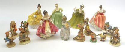 A group of figurines, comprising five Royal Doulton examples, Southern Belle HN2229, Simone HN2378,