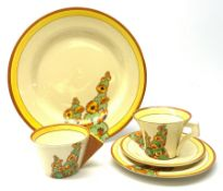 A Clarice Cliff Bizarre by Wilkinson Limited dinner plate, trio and cup in the Sunshine pattern. (5)