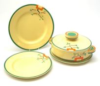 A Clarice Cliff Bizarre by Wilkinson/Newport Pottery vegetable tureen and cover, dinner plate and tw