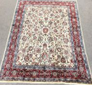 Persian Hamadan red and ivory ground rug, repeating border, central medallion in field of trailing f