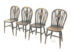 Set four 20th century wheel and hoop back chairs with elm seats, turned supports