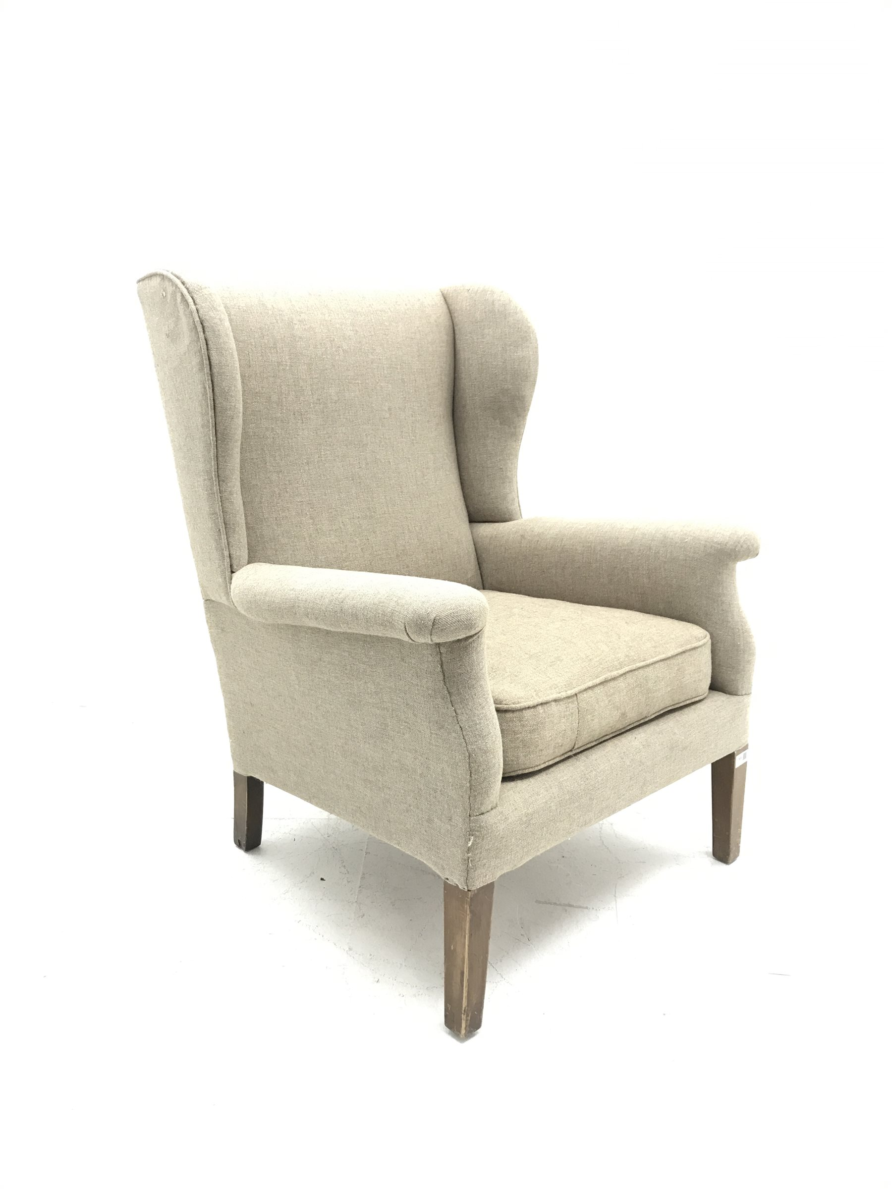 Vintage Parker Knoll wing back armchair, upholstered in natural fabric, W75cm, H97cm