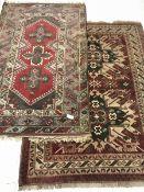 Turkish red ground rug, geometric design, the field decorated with three star motifs (198cm x 120cm)