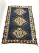 Turkish blue ground rug, three central medallions, 197cm x 134cm