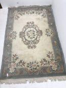Chinese beige and blue ground washed woollen rug, 277cm x 187cm