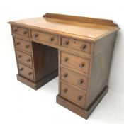 Victorian mahogany twin pedestal desk, moulded rectangular top with raised back, fitted with nine dr