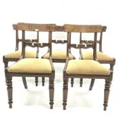 Set five early 19th century mahogany dining chairs, figured back rests above scroll and leaf carved