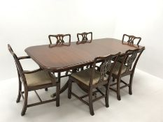 Wade Georgian style mahogany twin pedestal extending dining table, turned supports on shaped brass c