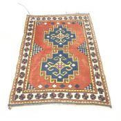 Turkish red ground rug, repeating border, 182cm x 132cm