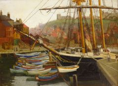 John Ernest Foster (British 1877-1968): Cobles Moored at Whitby, oil on panel signed 29cm x 40cm