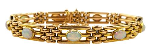 Early 20th century gold three bar link and nine stone opal bracelet