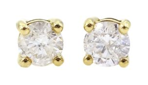 Pair of 18ct gold round brilliant cut diamond stud earrings