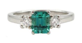 Platinum three stone fine emerald and diamond ring